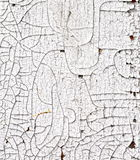 Cracking white paint. Cracked white paint on an old door Royalty Free Stock Photography