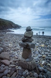 Crackington Haven in Cornwall Uk England. Crackington haven in cornwall, england, uk with pebble stacks and people roam the beach full of pebbles Stock Image