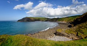 Crackington Haven. Panoramic view of the beach and cliffs at Crackington Haven near Bude on the north coast of Cornwall, from the foot of the Cambeak Headland stock photography
