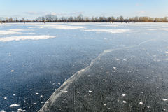 Crackle in Ice. Kiev/Ukraine - January 07, 2015 -The Dnieper river is frozen. Fishermen are waiting to catch some fish on the crackeling ice Royalty Free Stock Photos