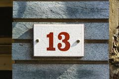House number thirteen 13. Crackled house number thirteen 13 Stock Image
