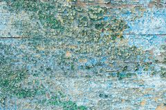 Crackled paint on wooden surface Abstract background royalty free stock photo