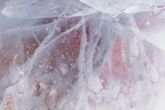 Crackled translucent ice texture  with pinkish and orange picking Royalty Free Stock Photography