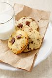 Crackling cookies on paper and fresh milk Stock Photo