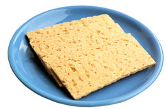 Crackling rye bread on a blue ceramic plate. Stock Photography