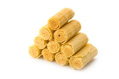 Crackling wafers-tubules. Isolated crackling wafers-tubules on a white background royalty free stock photos