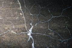 Cracks. Cracked black wall texture, backgrounds stock photography