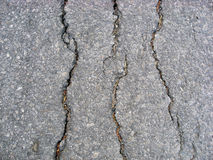 Cracks on asphalt background Stock Images