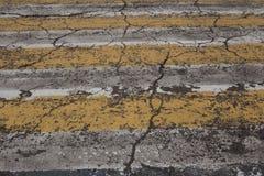 cracks on asphalt stock images