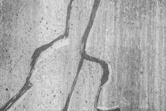 Cracks in Cement Grey Wall Royalty Free Stock Image
