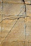 Cracks in granite. Close-up of a cracked granite surface on the coast of White Sea, Russia stock photo