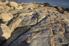 Cracks in grantite rock along the coast of Connecticut. stock images