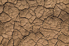 Cracks in the ground. Parched land on the field for the extraction of bentonite clay stock photo