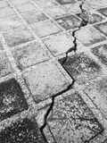 Cracks in the old pavement stones dirty Royalty Free Stock Photo
