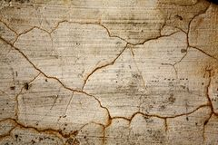 Cracks on old wall. Close-up at cracks on the old wall Royalty Free Stock Photo