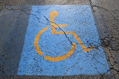 Handicapped Parking Cracked Royalty Free Stock Images