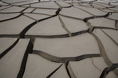 Cracks on terrain. Arid terrain with deep cracks stock images