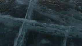 Cracks in transparent ice. Beautiful winter Lake Baikal stock footage