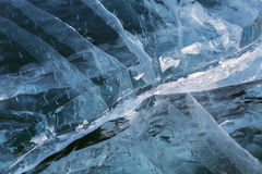 Cracks in transparent ice. Royalty Free Stock Photos