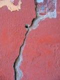Cracks wall.Textura. Red wall with cracks .Broken wall Stock Photo