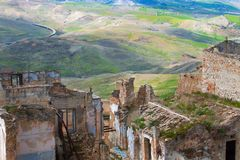 Craco - ghost town and green fields of region Basilicata, Italy Stock Photos