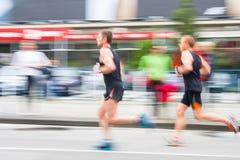 Cracovia Marathon. Runners on the city streets Stock Photo