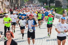 Cracovia Marathon. Runners on the city streets on May 18, 2014 in Krakow, POLAND Royalty Free Stock Photos