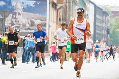 Cracovia Marathon. Runners on the city streets on May 18, 2014 in Krakow, POLAND Royalty Free Stock Images