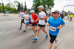Cracovia Marathon. Runners on the city streets on May 18, 2014 in Krakow, POLAND Royalty Free Stock Image