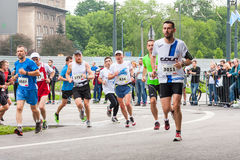 Cracovia Marathon. Runners on the city streets on May 18, 2014 in Krakow, POLAND Royalty Free Stock Photo