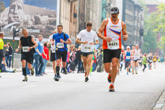 Cracovia Marathon. Runners on the city streets on May 18, 2014 in Krakow, POLAND Royalty Free Stock Photography