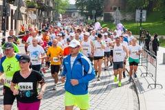 Cracovia Marathon. Runners on the city streets on May 18, 2014 in Krakow, POLAND Stock Photos