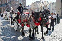 CRACOVIA, POLAND/EUROPE - 19 SETTEMBRE: Trasporto e cavalli in Kr Immagini Stock Libere da Diritti
