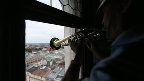 Cracovian Hymn played by a trumpeter from the highest tower of St. Mary`s Church in Krakow. stock video