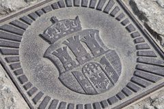 Cracow Coat of arms / arm made of metal. Symbol of Krakow city emblem closeup. Concept of Cracow steel family crest. Cracow Coat of arms / arm made of metal stock photography