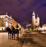 Cracow (Krakow) in Poland. The Main Market Square in Cracow is the most important square of the Old Town in Cracow, Poland. In the background is St. Mary's Royalty Free Stock Photo