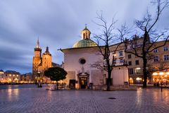 Cracow (Krakow) in Poland. The Main Market Square in Cracow is the most important square of the Old Town in Cracow, Poland. In the background is St. Mary's Stock Photography