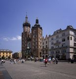 Cracow (Krakow) in Poland. The Main Market Square in Cracow is the most important square of the Old Town in Cracow, Poland. In the background is St. Mary's Royalty Free Stock Photography
