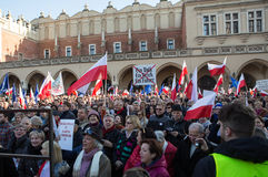 Cracow, Main Square - The demonstration of the Committee of the Protection of Democracy. CRACOW, POLAND - DECEMBER 19, 2015: Cracow, Main Square - The stock image