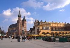 Cracow, Poland. Mariacki Church and Sukiennice in Cracow, Poland stock photo