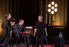 The American jazz vocalist Stacey Kent with her accompanying quartet. Cracow, Poland - April 26, 2018: The performance of the American jazz vocalist Stacey Kent Royalty Free Stock Image