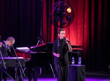 The American jazz vocalist Stacey Kent with her accompanying quartet. Cracow, Poland - April 26, 2018: The performance of the American jazz vocalist Stacey Kent Stock Images