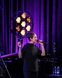 The American jazz vocalist Stacey Kent with her accompanying quartet. Cracow, Poland - April 26, 2018: The performance of the American jazz vocalist Stacey Kent Royalty Free Stock Photo