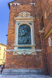 Cracow-Poland-brick wall of Mariacki Church. Cracow (Krakow)-Poland-bronze plaque of King Jan III Sobieski, 200th anniversary of rescue mission during Battle of Stock Photos