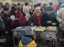 Christmas Eve for poor and homeless on the Main Square in Cracow. Every year the group Kosciuszko prepares the greatest eve in the Royalty Free Stock Photos
