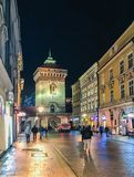 CRACOW, POLAND - January 24, 2018: January evening in Florian Street in the historic center of Krakow with the gates of St. Floria. This picture was taken in Stock Photos