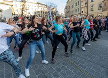 International Flashmob Day of Rueda de Casino. Several hundred persons dance Hispanic rhythms on the Main Square in Cracow. stock photography