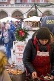 Cracow, Poland. Oscypki seller Royalty Free Stock Images