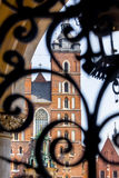 Cracow, Poland- Saint Mary s Basilica-Mariacki church. Saint Mary s Basilica-Mariacki church-Cracow, Poland- view through ornate, decorative, twisted iron bars Stock Photography