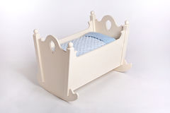 Cradle. Old white cradle with a blue towel royalty free stock photos